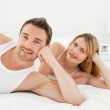 Happy lovers looking at the camera — Stock Photo