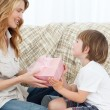 Mother offering present to her son — Stock Photo