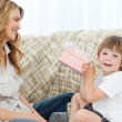 Happy children with his gift — Stock Photo #10841577