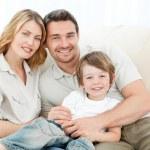 Happy family on their sofa — Stock Photo #10841592