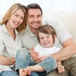 Happy family on their sofa — Stock Photo