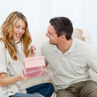 Man offering a gift to his wife — Stock Photo #10841621