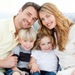 Cute family in their sofa — Stock Photo #10841862