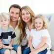 Cute family in their sofa — Stock Photo #10841864