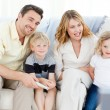 Stock Photo: Adorable family watching tv