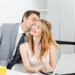 Businessman kissing her girlfriend — Stock Photo