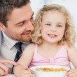 Father having breakfast with her daughter — Stock Photo