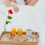 Lovers sleeping after having breakfast — Stock Photo