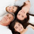 Family lying down on their bed — Stock Photo #10842386