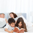 Parents talking while their childrens are reading — Stock Photo #10842396