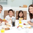 Stock Photo: Family having breakfast in kitchen