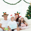 Family during Christmas day looking at the camera — Stock Photo #10842458