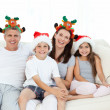 Family during Christmas day looking at the camera — Stock Photo