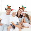 Family during Christmas day looking at the camera — Stock Photo #10842463