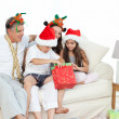 Family during Christmas day looking at their presents — Stock Photo #10842470