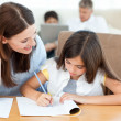 Mother helping her daughter for her homework — Stock Photo #10842493
