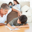 Royalty-Free Stock Photo: Father helping his son with his homework