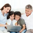 Family looking at the laptop — Stock Photo #10842514