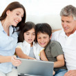 Family looking at  the laptop - Stock Photo