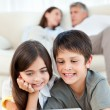Lovely children watching a movie on their laptop at home - Foto Stock