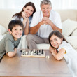 Portrait of a little family in their living room — Stock Photo
