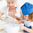 A little girl  baking with her grandmother — Foto de Stock