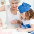 A little girl  baking with her grandmother — Stock Photo