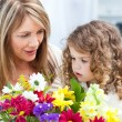 Grandmother with a little girl taking flowers — Foto Stock