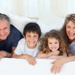 Family in their bedroom looking at the camera at home — Stock Photo