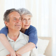 Senior couple hugging on their bed — Stock Photo