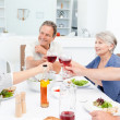 Retired friends toasting together — Stock Photo