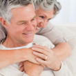 Mature woman hugging her husband — Stock Photo #10843761