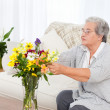 Senior woman with flowers — Stock Photo #10843893