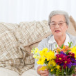 Senior woman with flowers — Stock Photo #10843894