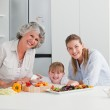 Family cooking together in the kitchen at home — Stock Photo