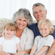Joyful family looking at camera — Stockfoto #10844036