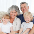 Stock Photo: Joyful family looking at camera