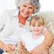Grandmother helping her little girl to knit — Stock Photo
