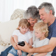 Family looking at their camera — Stock Photo #10844091