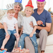 Happy family looking at the camera on a birthday — Stock Photo