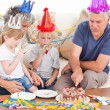 Family eating the birthday cake together — Stock Photo #10844106