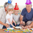Family eating the birthday cake together — Stock Photo