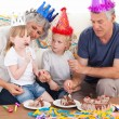 Family eating the birthday cake together — Stock Photo #10844111