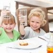Children toasting with their drink — Stock Photo