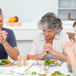 Adorable family praying at the table — Stock Photo