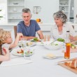 Pretty family at the table together — Stock Photo