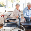 Lovely retired couple talking on the sofa — Stock Photo #10844178