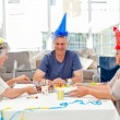Mature friends on birthday — Stock Photo