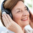 Senior listening to music — 图库照片