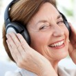 Senior listening to music — ストック写真